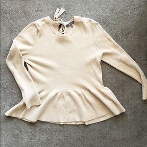 EUC peplum sweater with bow back